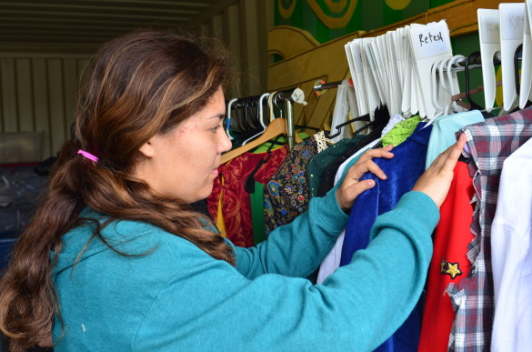 """Hanna Rohfeld ('16) sorts through costumes for """"The Wizard of Oz."""""""