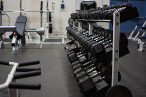 The athletics department replaced the old weight room equipments with new dumbbells. Photo by: Alex Tran