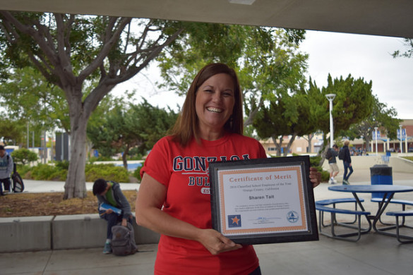 Sharon Tait poses with her big smile and the 2016 Classified School Employee of the Year Award