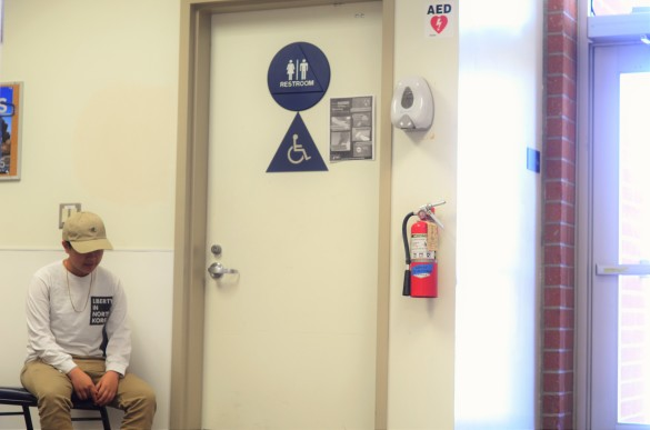 Ash Diep ('17) waits for his turn to use the only  gender neutral and single stalled bathroom at Fountain Valley High School. Photo by Steve Phan.