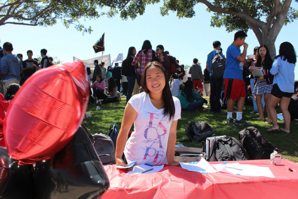 Co-president of Arts for Hearts Sarah Kwok welcomes potential members at Club Rush.
