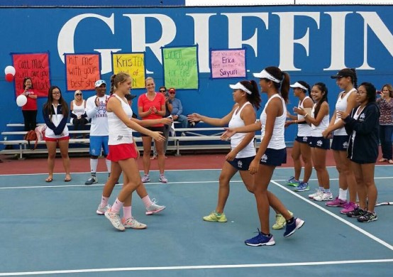 Clarissa Htay ('17) and Vikki Nguyen ('18) shakes hands with no. 2 doubles from Los Al before the match. Photo provided by Perry Htay