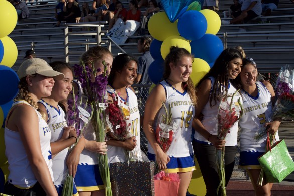 Seniors from the Varsity and Junior Varsity team come together to celebrate their last game of the season and high school.