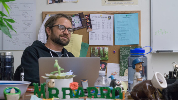 Mr.Barro kicking back and relaxing in his pleasant classroom. Photo by Jake Winkle