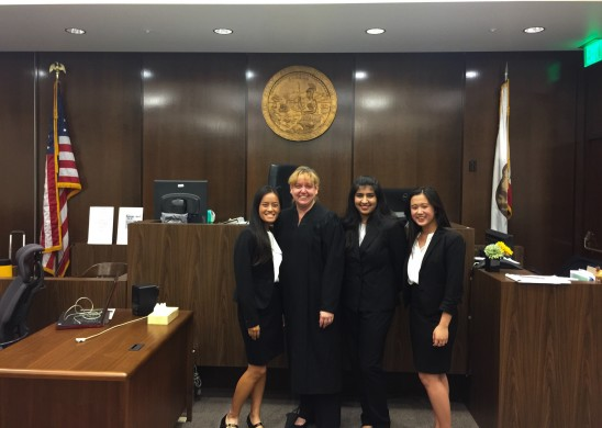 Defense attorneys with judge (left to right) Ally LeNguyen ('17), Presiding Judge Karen Scott, Divya Seth ('17), and Kaitlyn Truong ('18). Photo by John Le.